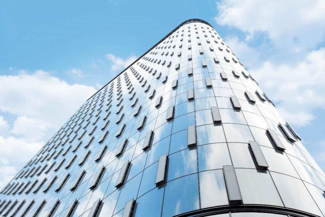 Low-emissivity glass, ultra-low-VOC coatings integral to sustainable double-skin façade.