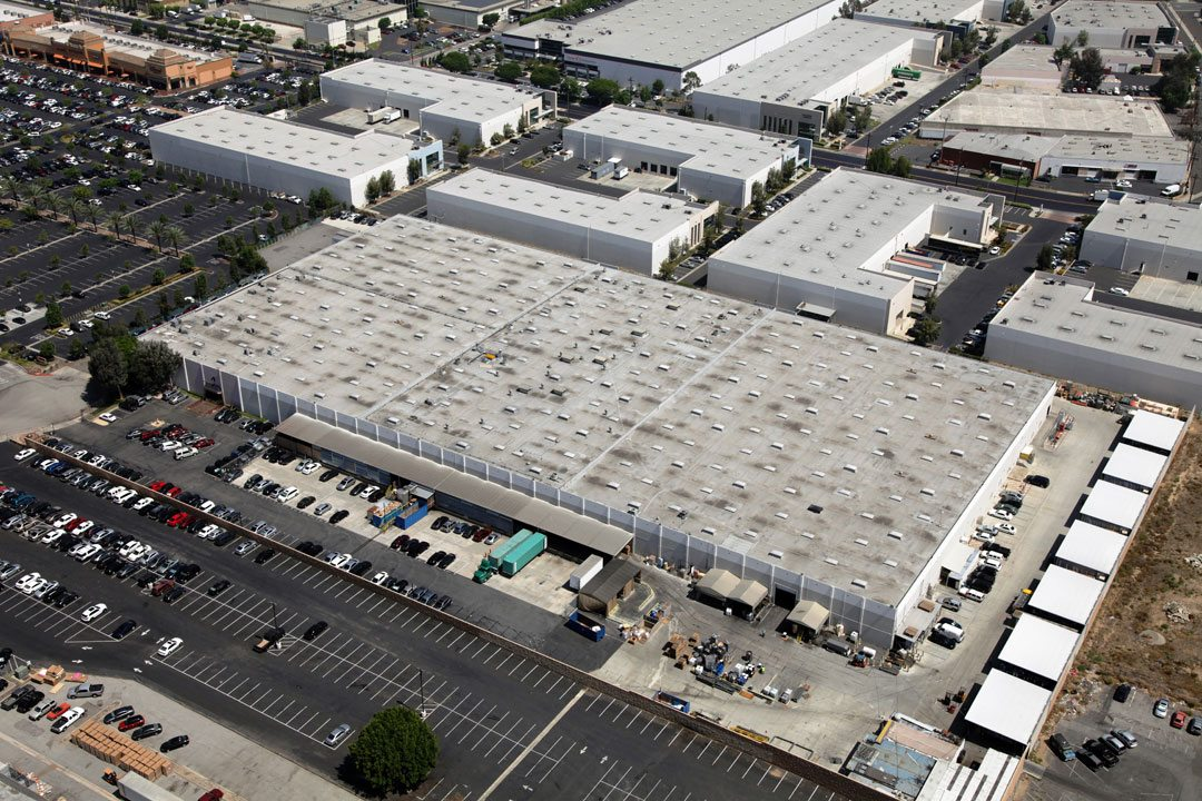 A Look At The American International Industries Facility Before Their  Reroof Performed By Highland Commercial Roofing