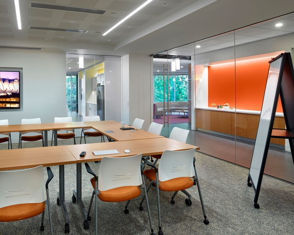 Saint-Gobain Glass is featured in this training room pictured above. Specifically, SGG STADIP®, a laminated glass paired with Sekurit frameless safety glass, offers a range of acoustic properties helping to keep the training room quiet while permitting views of the outside. Gyptone® and Gyptone® Quattro perforated panels and ceiling tiles further enhance the acoustics to make this workspace more productive. Photo: © Jeffrey Totaro