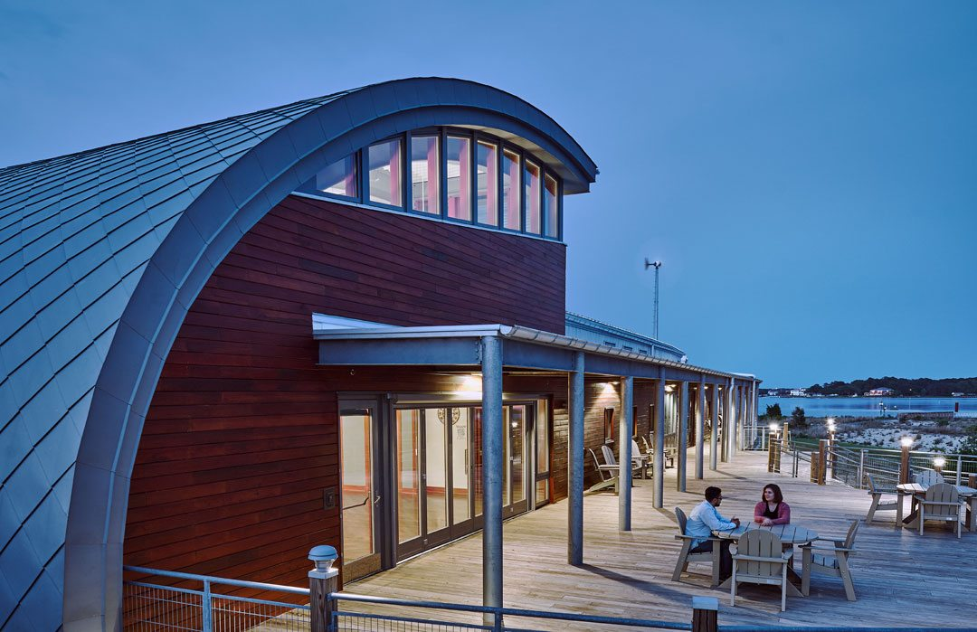 The south deck swells in plan adjacent to the conference room, creating a large gathering space for formal and informal gatherings, with unmatched views to the bay beyond. Brock Environmental Center, Virginia Beach, Va. Credit: © Prakash Patel Photography