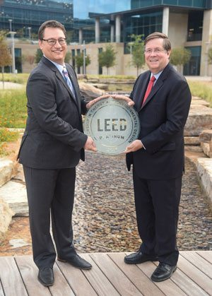 TMNA CEO Jim Lentz (right) receives the LEED Platinum from Jonathan Kraatz (left), executive director, U.S. Green Building Council, Dallas Chapter, for green building techniques on September 21, 2017.