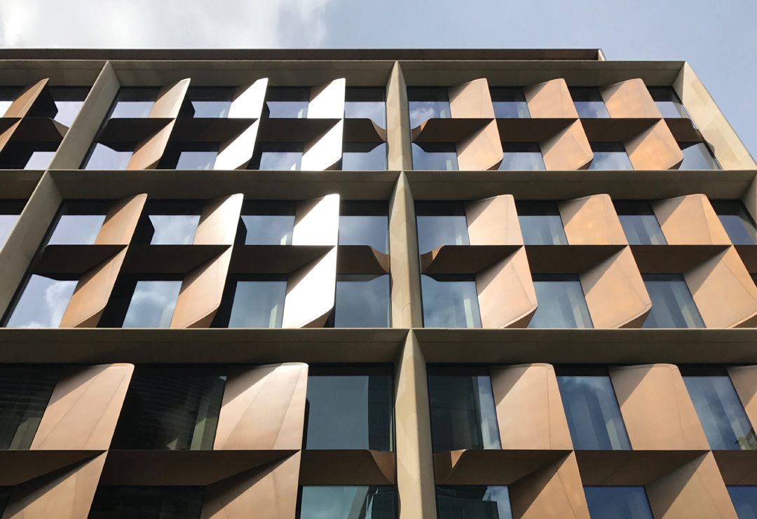"""The building's distinctive bronze blades can open and close, allowing the building to operate in """"breathable"""" natural ventilation mode. Credit: 'Bloomberg'"""