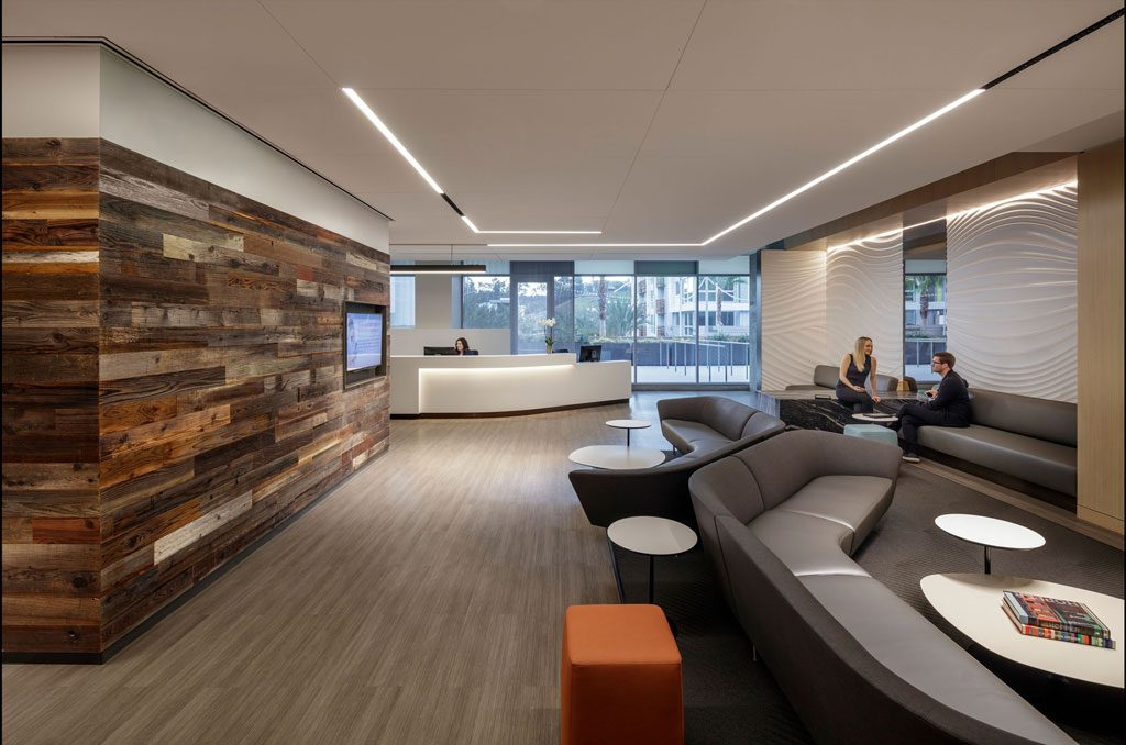 Floor-to-ceiling windows along the southern façade flood the layered spaces with natural light, where custom, hospitality-style furnishings and finishes were developed using healthcare-compliant materials. The result is a welcoming, healing environment for all. Photo ©Tim Griffith.