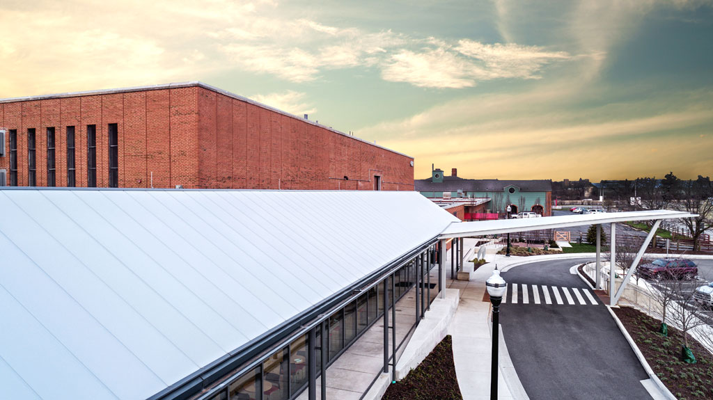 The EXTECH SKYSHADE 8000® standing seam, translucent canopy system is engineered for long spans, snow loading conditions and to withstand extreme wind loads including in hurricane-prone areas. Photo by Cory Klein