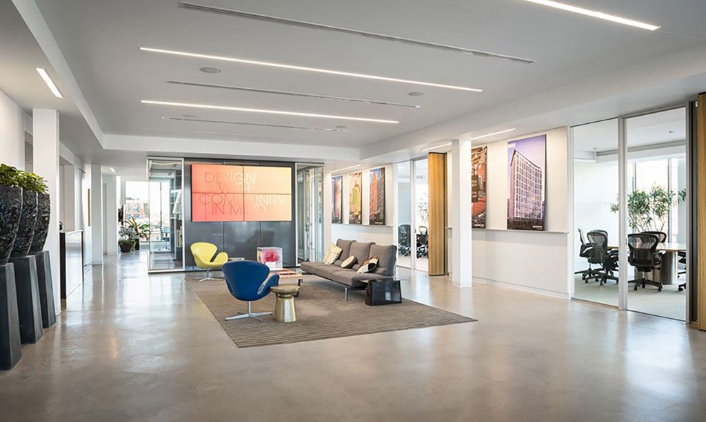 The sixth-floor lobby in Stantec's Boston office serves as a multi-use space, which accommodates everything from all-staff meetings to yoga classes and community events.