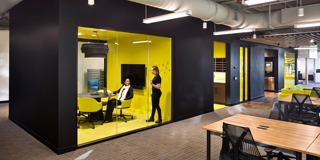 The Life Lab's first floor features an open layout anchored by a black-painted core that houses enclosed meeting rooms, phone booths, and a kitchen. Photo: ©Robert Benson Photography