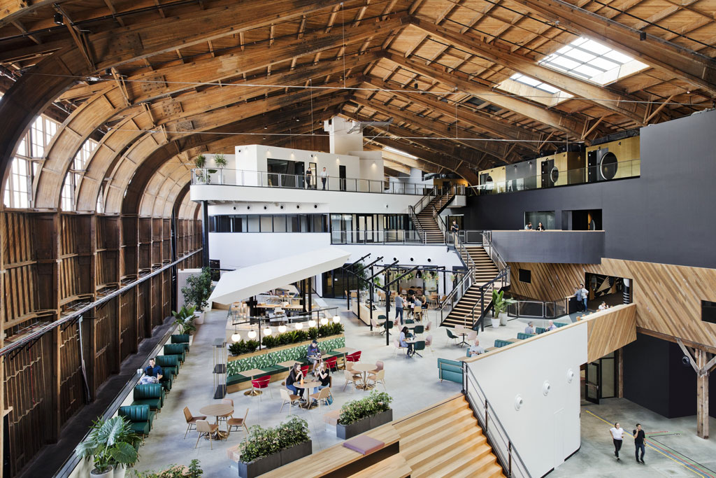 The design and spirit of the original hangar was preserved, while creating a modern workspace for Google and YouTube employees. Photo by Connie Zhou, courtesy of Google