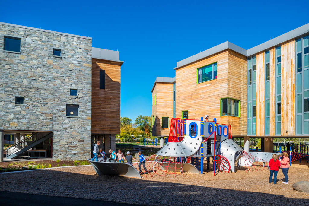 MacArthur Elementary includes three 2 -story classroom wings are raised on columns to allow the river to flood and recede naturally over time. Photo: John Griebsch Photography