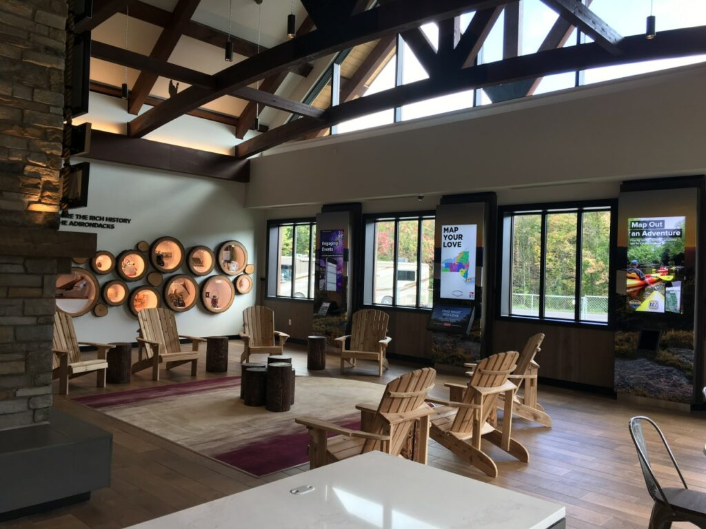 The interior of the Adirondacks Welcome Center includes rustic elements and materials, reminiscent of local design. Courtesy of Stantec