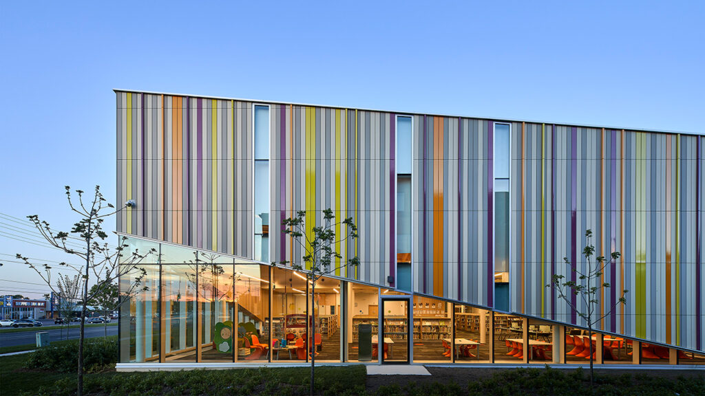 2019 AIA/ALA Library Building Award Recipient Albion Public Library, Toronto, Ontario. Library Entrance: Reminiscent of a walled garden, the dynamic façade gives the illusion of a front porch trellis, injecting colour into the street. The lifting of this veil allows natural light to enter and views to the landscape from inside. Photo credit: doublespace photography