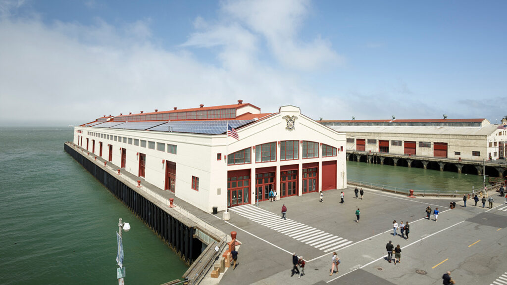 The completed rehabilitation with rooftop solar PV which provide 100% of the electrical requirements for the Pier 2. Photo credit: © Bruce Damonte