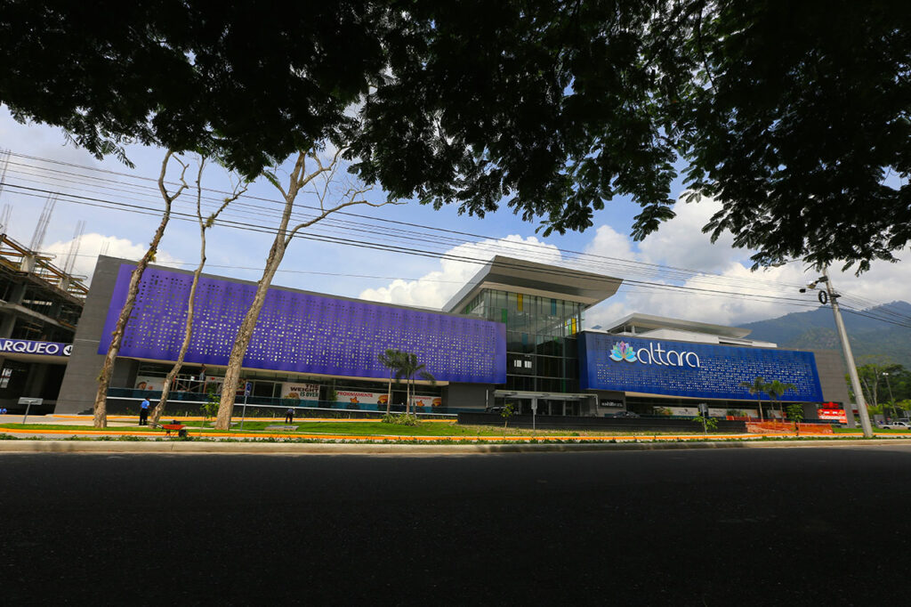 Sherwin William's Fluropon Effects Kameleon™ Colors were used to create a dynamic façade for the Altara Center business park in Honduras. Depending on time of day and lighting or perspective, the colors appear to shift. (Photos from Alpolic)