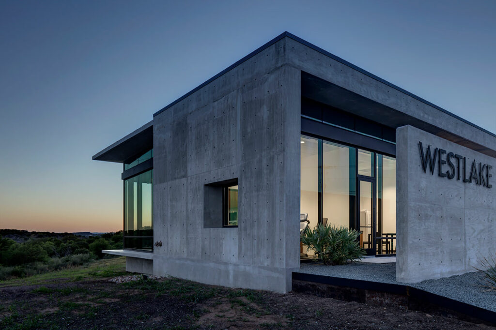 While uniform in size and shape at a glance, the concrete shell adapts to functional requirements such as the tapered, deep overhang that provides shade in conjunction with the fritted glass. Credit: Charles Davis Smith