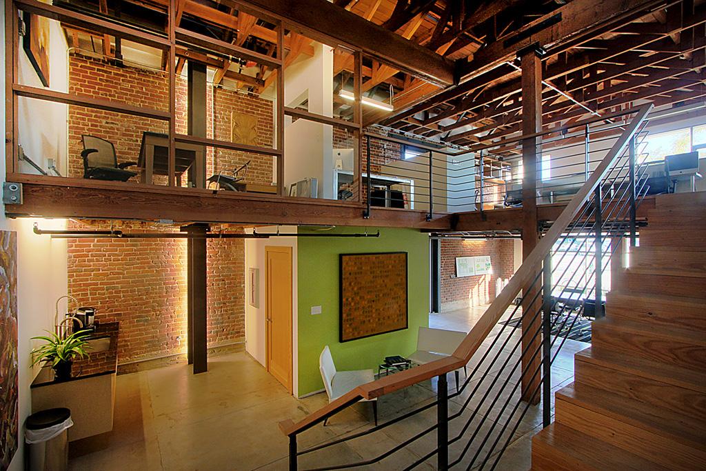 Creative office interior includes extensive reuse of original materials. Photo: © RMA Photography Inc.