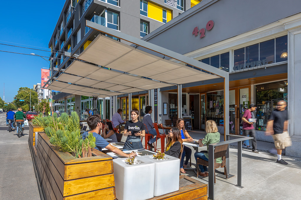 Studio One Eleven designed and co-developed components of Fourth + Linden, now anchored by The Linden apartments. The parklet in the foreground is just the second parklet created in California. Photo: © RMA Photography Inc.