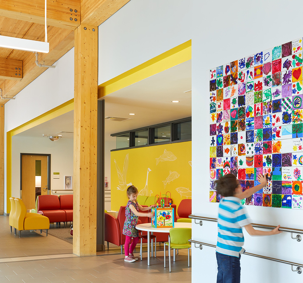 'Memory tiles,' seen at the right side of the photo, let kids leave a piece of themselves on the building – something especially meaningful for clients that have been coming to ErinoakKids for years. Courtesy of Stantec