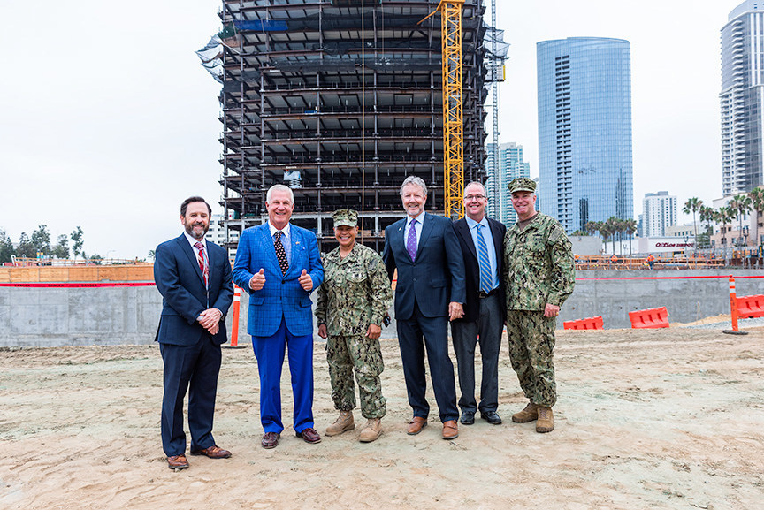 US Navy Region Southwest Headquarters Topping Out Ceremony. Mr. Joe Stuyvesant, Executive Director, Navy Region Southwest; Papa Doug Manchester, Manchester Financial Group; Rear Adm. Bette Bolivar, Commander, Navy Region Southwest; Perry Dealy, Dealy Development Inc.; John Greenip, Turner Construction Company; Capt. Matt Ovios, Chief of Staff, Navy Region Southwest. Photo credit: Javier Laos Photography/La Jolla Visions