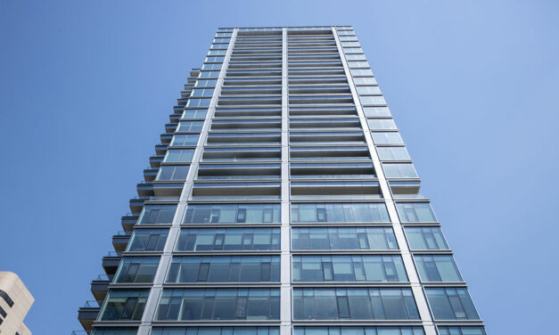 Franklin Tower transforms former offices into luxury living, re-clad in glass and metal with wood grain finishes from Linetec