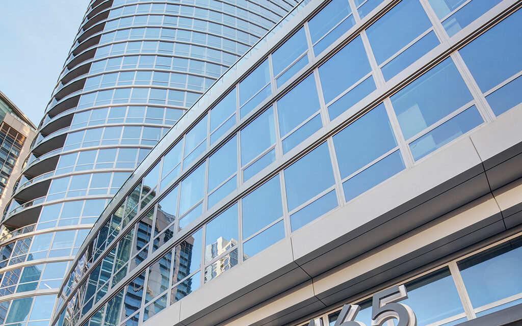 Contemporary, curvy curtainwall creates comfortable, sustainable, luxury residences using Technoform's thermal barrier strip and warm edge spacer
