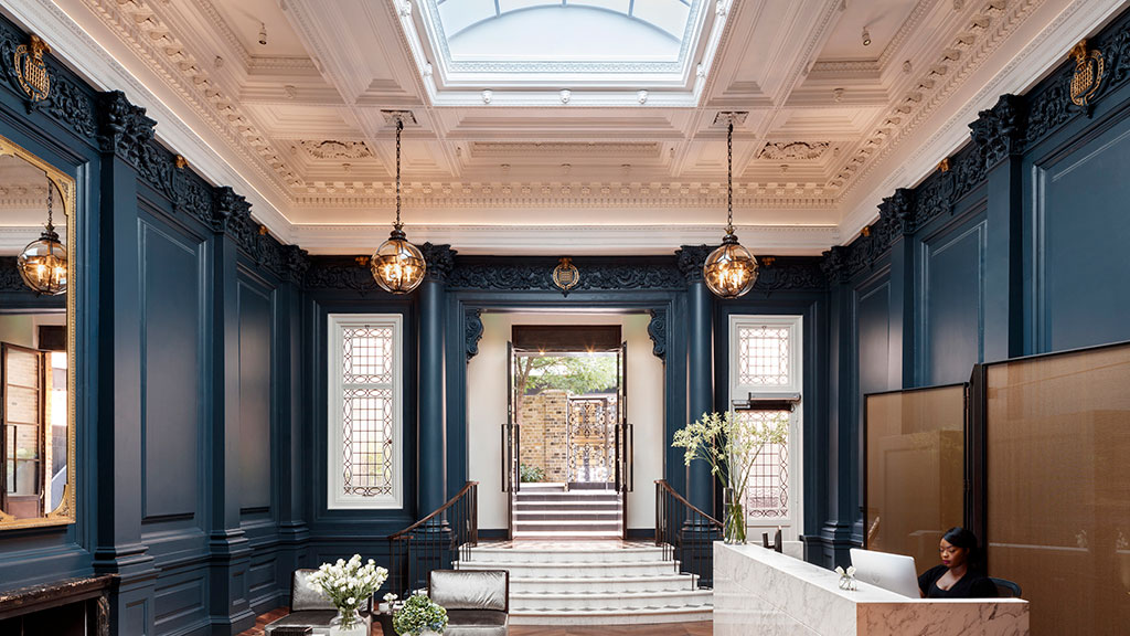 Historic interiors have been restored and re-imagined, including the former boardroom of the Westminster Fire Office, now the main residential entrance. Photo credit: © Philip Durrant.