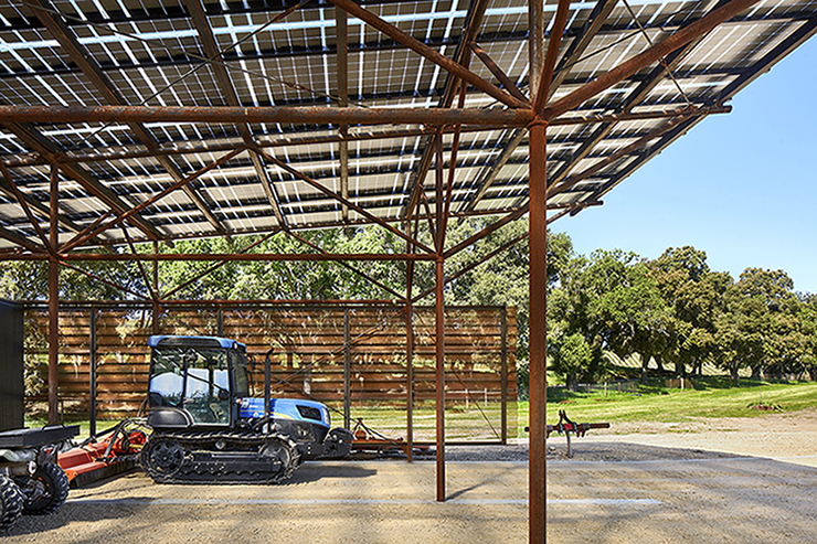 The laminated glass PV modules provide solar harvesting and the primary roof covering. Photo credit: Casey Dunn