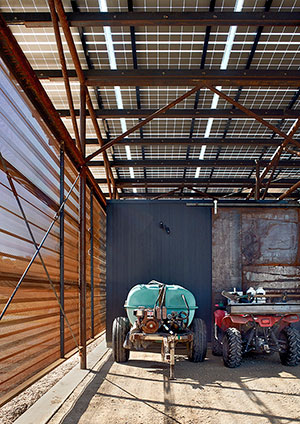 Wood storage and workshop spaces are clad with Ebonized Cedar paneling. Photo credit: Casey Dunn