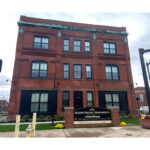Historic motorcycle factory converted into new, affordable housing features high-performance windows