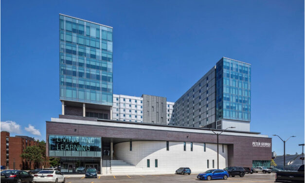 SOLARBAN® glass with acid-etched panels help university building function as mini-city