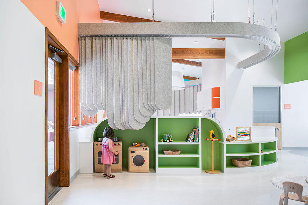 Felt curtains and play shelves define the classrooms of The Nest. Photo by Here And Now Agency